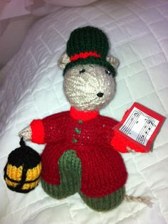 Knitted Dickensian Christmas carol singing mouse. Pattern by Alan Dart.