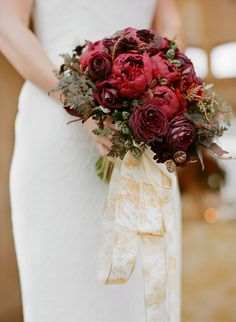Dramatic red and burgundy #peony and #rose bouquet from #MaxGill. Photo: Josh Gruetzmacher. See the full post here: http://snippetandink.com/red-and-gold-valentine-wedding-inspiration-styled-shoot/