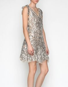 Sparkle party dress with tie shoulder straps.     (note: a dress that still looks cute if you dont have boobs to fill it!)
