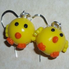Chick Earrings made of yellow fimo clay dangling on Sterling silver wires. http://www.judesjewels.co.uk/ourshop/prod_3192352-Chicks-Earrings-Handmade-Fimo-Sterling-easter.html
