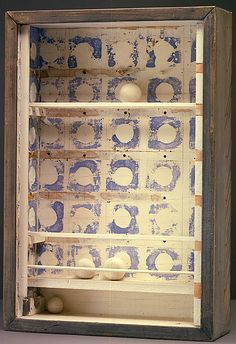 """""""Colombier (Dovecote #2),"""" c. 1950, Joseph Cornell. Tempera and ink on newsprint, wood and glass; 19 x 12 7/8 x 4 in. (48.4 x 32.7 x 10.2 cm.) Smithsonian American Art Museum."""