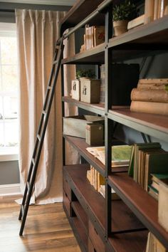 The shelving in the study has a ladder to access the top shelf, which is reminiscent of old library shelves.