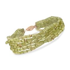 "Cylinder Peridot Six-Strand Bracelet in 14kt Yellow Gold. 7.5"" Features 90.00 ct. t.w. peridots. Bracelet has 14kt yellow gold spacers and clasp.*150"