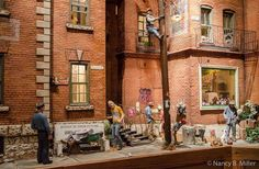 Explore Michael Garman's square foot family friendly miniature city filled with hundreds of handmade characters, holograms and visual effects. Pottery Houses, Doll House Plans, Model Train Layouts, Moving House, Model Building, Small World, Stop Motion, Model Trains, Scale Models