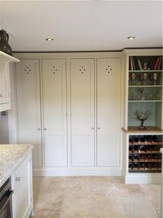 Gorgeous new larder cupboards in new kitchen in Off White along with wine rack and dresser top with inset colour of Vert de Terre.