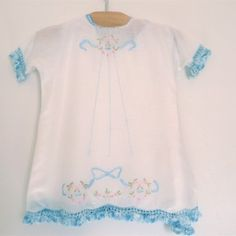 blue trim c. 1920 loose fitting simple cotton dress finished with a blue crocheted trim and embroidery. 3 small buttons in back. matching...