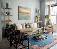 living room with blush blue and white designer pillows - interior designer Maddie Hughes