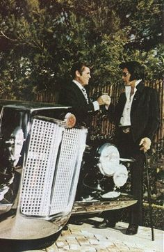 Accepting the keys for his Black Stutz Blackhawk at his Hillcrest home from dealership owner Jules Meyers in 1971.  Sinatra had vied with Elvis for the 'first Stutz Blackhawk ever sold,' but declined the publicity photos at delivery.  Elvis accepted the offer and thus was able to purchase the car.