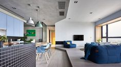 Taiwanese office HAO Design has completed the interior of this modern family apartment in Kaohsiung City for a family with two daughters. Open Plan Apartment, Green Apartment, Family Apartment, Apartment Ideas, Blue Accent Walls, Interior Architecture, Interior Design, Design Case, Home And Family