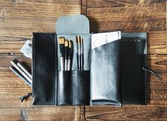 """The Sketch Book Case is constructed out of vegetable tanned leather.  Material: - Vegetable tanned Leather (1.2 - 1.6 mm thickness) - YKK metal zippers - Wooden Button - Waxed thread  Size: Closed - 243 mm (H) x 195 mm (W)  - 9.6 """" (H) x 7.7 """" (W) Opened - 243 mm (H) x 390 mm (W) - 9...."""