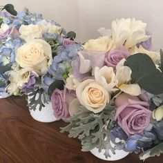 Floral by efw floral + design. Ocean song and ivory roses, dusty miller, freesia, eucalyptus, sweet peas, hydrangeas.   #efwfloralanddesign #floral #flowers #arrangment #bouquet #babyshower #rose #hydrangea #eucalyptus #freesia #sweetpea #delphinium #dustymiller #oceansongroses #oceansong #ivory #bluehydrangea #silverdollareucalyptus #lavender #lavendersweetpea #bluedelphinium #hobnail #hobnailglass