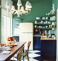 Cute little kitchen with green walls and white light chandelier. #kitchen