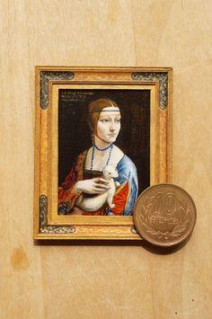 "Miniature reproduction work. Da Vinci.""Lady entertain the white ferret. acrylic on cardboard."