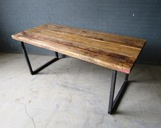 Here is our 6-8 seater dining table Made from reclaimed timber and steel The top is made from solid 2 1/2 thick timber. The grain and look of the wood is