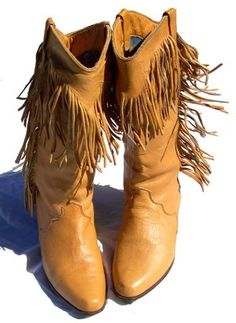 The ultimate statement piece!! i have to have these too dang cute fringe boots!