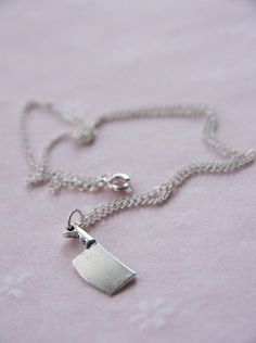 Cleaver Pendant Necklace$8.95, via Etsy. Michelle, we could really put some heads on the chopping block w/ this! Love it