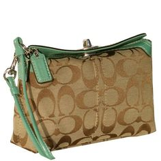 Netural Coach wristlet with teal accent