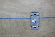 Light switch cut out on Shiplap Wall
