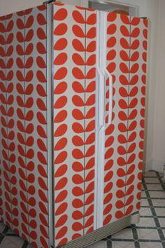 Wallpapered refrigerator.