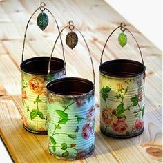 Decoupage napkins onto tin cans and spray with sealant. Punch holes in sides to add a wire hanger.  Now wouldn't these be pretty in your gar....