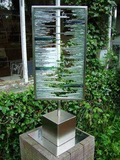 Brushed steel. glass shards Garden Or Yard sculpture by artist Jane Bohane titled: 'Splintered Vision'