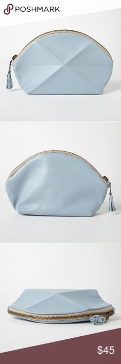 """SALE Blue Pyramid Pouch This beautifully designed pouch is practical and fashionable! Made from beautiful Italian leather it features a 3 dimensional leather pleat in the front. Use it to store makeup or as a small clutch.Measures 4.3"""" High x 7.8"""" Wide x 1.5"""" Deep. Fully Lined. Antique gold zipper with leather tassel. This pouch is from an online company I run which no longer sells this piece. It's handmade by an artisan called Lara Kazis and is brand new. Marks in leather are natural…"""