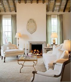 Design Element: Venetian Mirrors. I love the simplicity of this room and the rustic nature of the beamed ceiling.