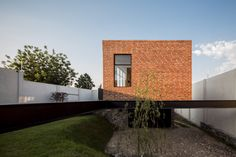 A brick volume containing a games room balances on steel beams that raise it above the sloping plot of this house in the Mexican city of Zapopan. Steel Beams, Micro House, Game Room, Brick, Stone, Gallery, Outdoor Decor, Photograph, Home Decor