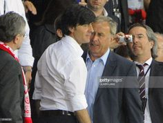 German coach Joachim Loew (2ndL) speaks with Austrian coach Josef Hickersberger (R) after being ordered out of the field during the Euro 2008 Championships Group B football match Austria vs. Germany on June 16, 2008 at Ernst Happel stadium in Vienna.