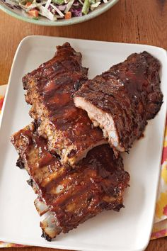 Oven BBQ Ribs – There are many reasons to like this recipe for Oven BBQ Ribs. But here's another one: They're a ridiculously easy way to please a crowd with just three ingredients required!