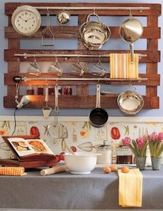 Hang your kitchen cooking and baking tools on your wall using a recycled pallet