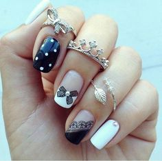 Nail Designs, polka-dots, butterflies, lace embroidery, and plain nail polish with studs.