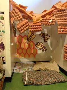 Bee hive imaginary play corner in preschool room at shelburne farms.