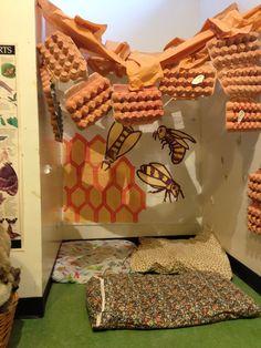 Bee hive imaginary play corner in preschool room at shelburne farms.