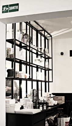 Bar shelving idea with antiqued mirror behind it....