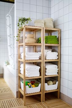 The open shelves of the IKEA MOLGER shelf unit keep all of your bath products including towels and toiletries organized and accessible!