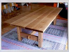 Quarter-sawn White Oak dining table in the Craftsman style of            Gustav Stickley. Solid wood joinery, 5 coats hand-rubbed tung oil,            Designed and Built by Nick, 2007