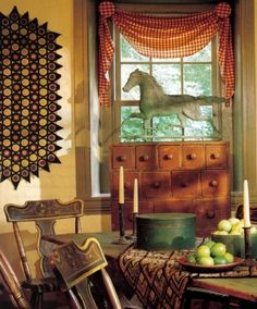 Primitive...love the penny rug and prancing horse, the curtains, table setting, apothecary, almost everything in this photo.