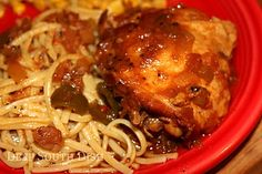 Crockpot Creole Chicken - Chicken thighs, slow cooked in a seasoned Creole sauce with The Trinity, and served with fettuccine noodles.