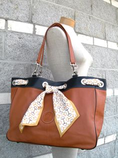 "LILO ""Susana"" luxurious leather bag with equestrian bit silk scarf."