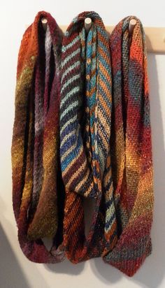 Ronbiais Loop. Knit on the bias in stockinette. Designer notes that the bias construction keeps the rolling down. Looks terrific worked in Noro yarn. Free pattern.  love - love - love this yarn!  Aran weight yarn
