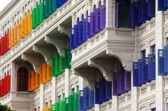 Colorful shutters...This is a real building in Singapore. It was an old prison that is now a government office.