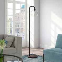 Bring a touch of modern elegance to your living room or bedroom with this eye-catching minimalist floor lamp. The arc of the lamp leads to a glass globe shade that adds sophistication and warm lines to the design of your home. Let this lamp's appealing blend of curves and angles illuminate your space in style. Features : Premium materials have been used making this lamp: glass in the shade, steel in the frame and base, UL certified wiring components. And the finishes are hand done: the brass… Flooring, Curved Floor Lamp, Floor Lamps Living Room, Black Floor Lamp, Lamp, Decor, Floor Lamp, Lamps Living Room, Room Lamp