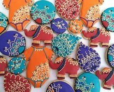 Rich Colors with Gold Bollywood Baby Shower Cookies Baby Cookies, Baby Shower Cookies, Royal Icing Cookies, Baby Shower Favors, Baby Shower Decorations, Sugar Cookies, Backdrop Decorations, Bollywood Baby Shower, Bollywood Party