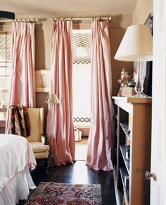bright room, dark floors, pink bedroom. A Welcome Home in New Orleans on domino.com