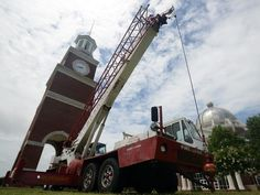 A crane is brought in on Monday, July 11, 2016, to