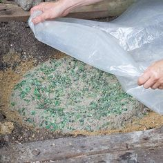 Spritz the basin with water so it cures properly. Cover the basin with sheet plastic; use a few rocks around the edge to hold it in place. Allow the concrete to cure for 3 - 7 days; longer curing enhances strength and durability.