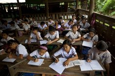 Ethnic Karen Burmese students study at a middle school inside the Mae La refugee camp, June 7, 2012 in Tak province, Thailand. The camp is situated along the Burma-Thailand border and is home to around 50,000 refugees. (Paula Bronstein/Getty Images) #