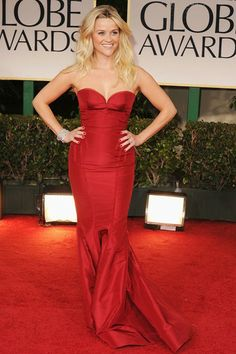 2012 - Reese Witherspoon in a red Zac Posen gown, Christian Louboutin heels and Fred Leighton jewels.