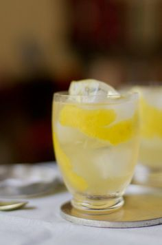 Lillet and Gin Lemonade 2 medium lemons for garnish Large ice cubes 1 ounce freshly-squeezed lemon juice 1/2 ounce honey or simple syrup 5 ounces chilled Lillet Blanc 1 ounce Hendricks Gin 4 ounces chilled club soda